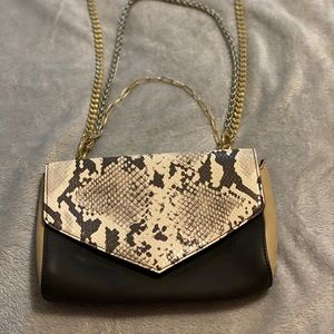 Snake print purse with silver and gold chains